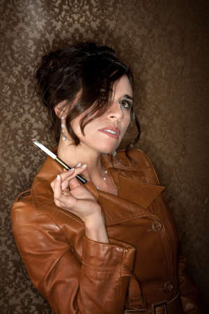 Woman in dark leather coat with cigarette