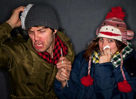Young Hipster Couple with Colds or the Flu photo