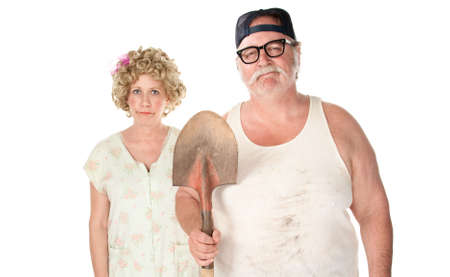 Senior couple with shovel in an American Gothic pose. photo