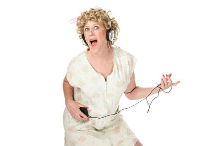 listening device: Housewife with listening device and headphones on white background Stock Photo