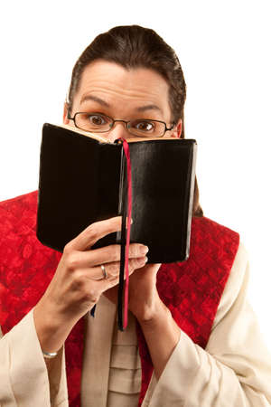 Female preacher with Bible and holy garments photo