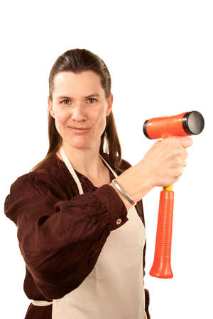 capable: Capable woman holding a large orange hammer Stock Photo