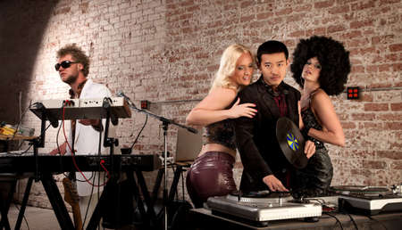 Daddy DJ with Ladies at a 1970s Disco Music Party photo