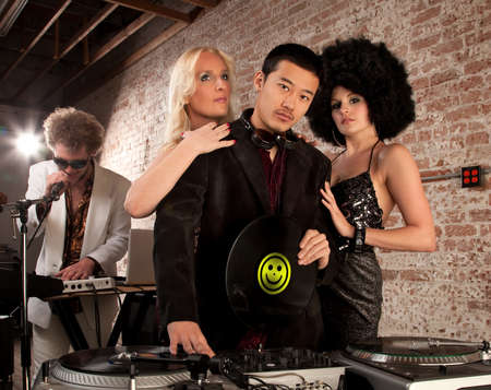 admirers: Desirable young DJ with two female admirers