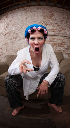 opinionated: Angry woman with curlers and robe complaining about loud music