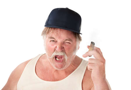 opinionated: Angry big man in tee shirt with cigar and baseball cap Stock Photo