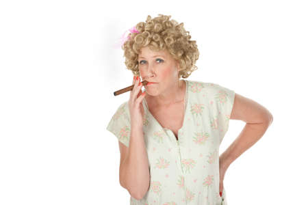 Housewife with cigar and hands on hips on white background