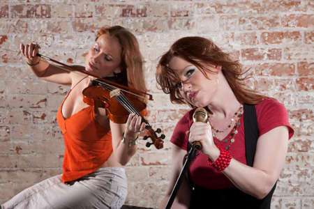 vocals: Two female musicians with violin and vocals