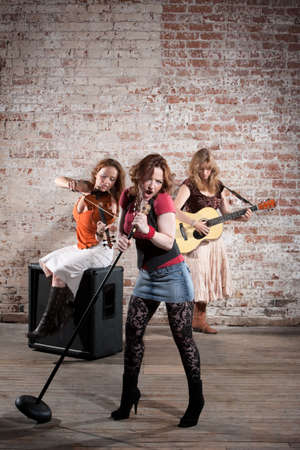 Country and western all girl band performing photo
