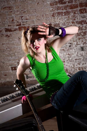 queasy: Young punk rocker in glare of light with instruments