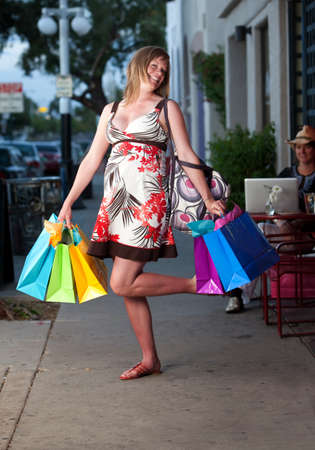 Cute pregnant woman shopping with colorful bags Stock Photo - 6989201