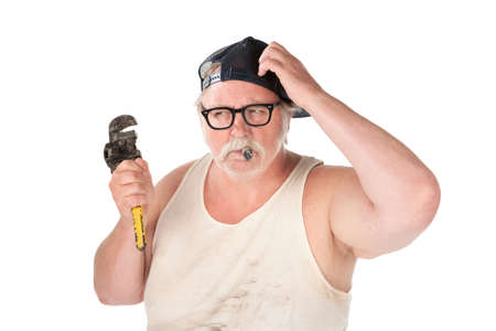 handy: Puzzled plumber with pipe wrench and cigar Stock Photo