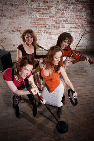 All-girl band performing in stylish clothing  photo