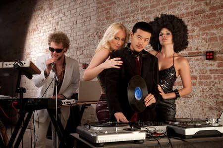 Handsome Asian DJ and Caucasian singer with ladies photo