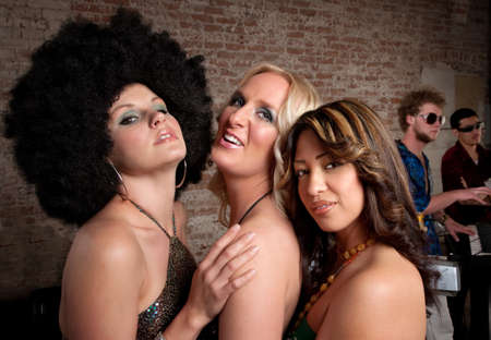 Three cute ladies posing at a 1970s Disco Music Party photo