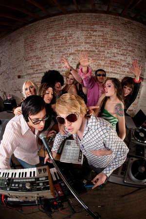 Singing DJsat a 1970s Disco Music Party photo