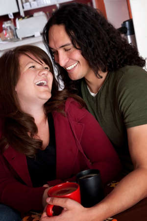 Caucasian and Native American couple embracing at a cafe photo