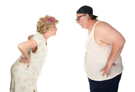 spat: Bickering couple facing each other on white background Stock Photo
