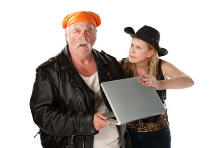 spat: Mature biker couple arguing about a computer Stock Photo