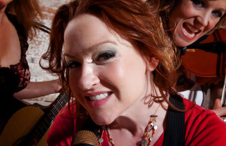 All girl band performing with redhead singer photo