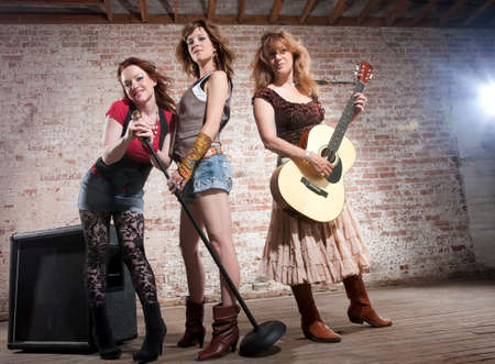 All girl trio performing in stylish clothing  photo