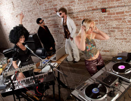 Female DJs performing at a 1970s Disco Music Party photo