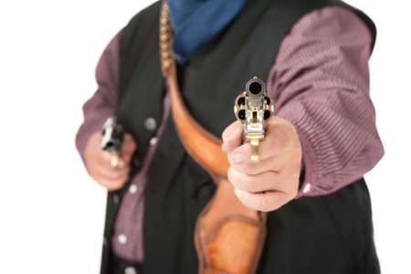 shootout: Shootout with two pistols held by cowboy