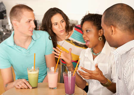 Two couples at a cafe drinking frozen beverages. Horizontal shot. Stock Photo - 7214412