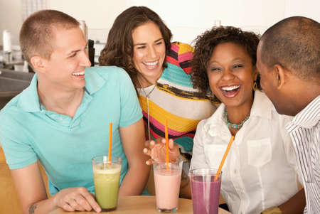 Two couples at a cafe drinking frozen beverages. Horizontal shot. Stock Photo - 7214401