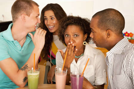 Two couples at a cafe drinking frozen beverages. Horizontal shot. Stock Photo - 7214662