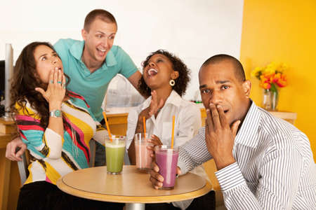 Two couples at a cafe drinking frozen beverages. Horizontal shot. Stock Photo - 7214466