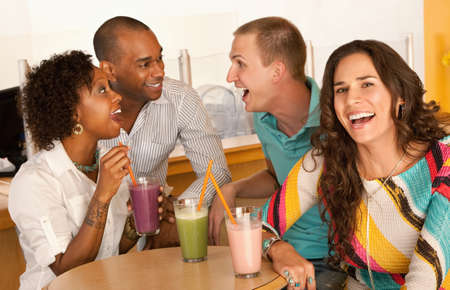 Two couples at a cafe drinking frozen beverages. Horizontal shot. photo