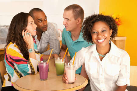 Two couples at a cafe drinking frozen beverages. Horizontal shot. Stock Photo - 7214414