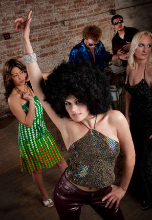 Pretty girl with afro wig at a 1970s Disco Music Party photo