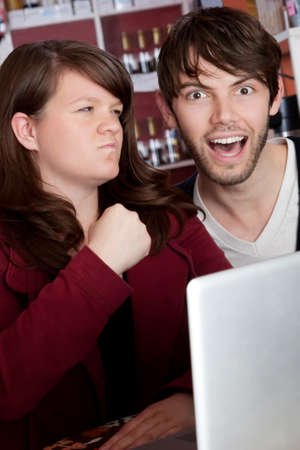 Angry woman threatening spouse over internet abuse photo