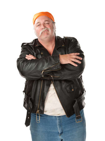 mean: Smirking biker gang member with leather jacket Stock Photo