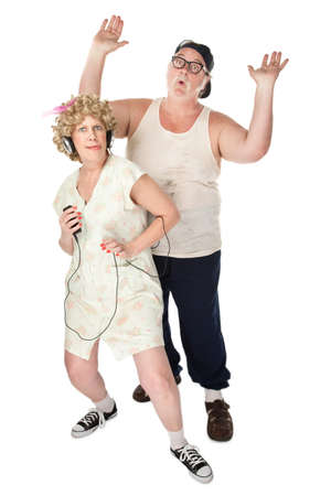 wife beater: Wife dancing to music with an annoyed husband