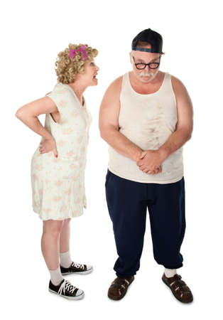 Poorly dressed couple engaged in a serious argument photo