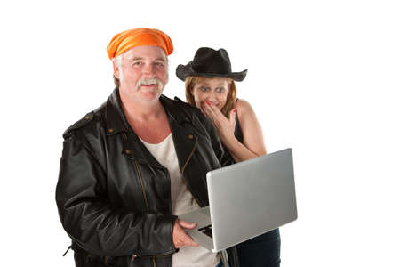 Biker couple giggling about something on a laptop photo