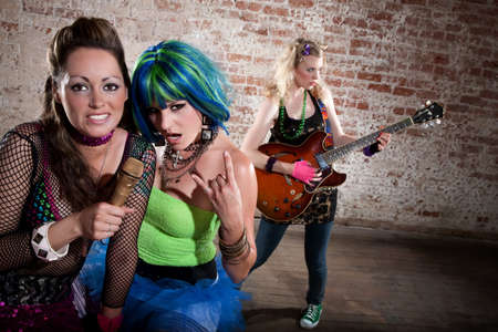 Young all girl punk rock band performing photo