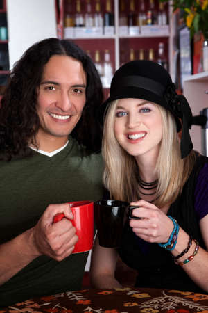 Interracial couple together at a coffee house photo
