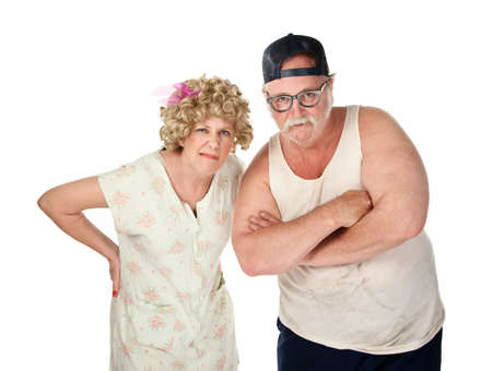 wife beater: Judgemental older couple with dirty clothes on white background