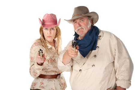 stickup: Couple in western wear pointing pistols with serious faces