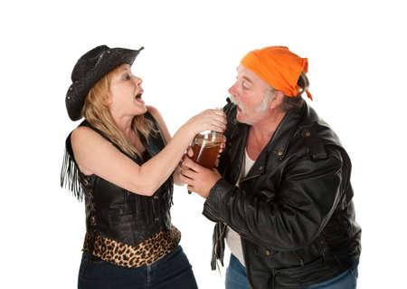 Gang member couple wrestling over a beer bottle photo