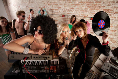 Cool female DJs performing at a 1970s Disco Music Party