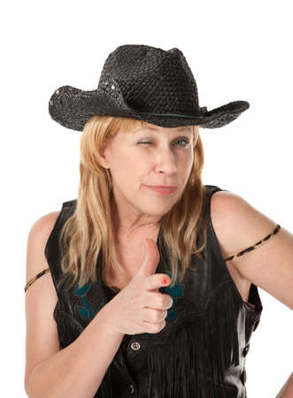 Winking middle-aged woman with black cowboy hat Reklamní fotografie