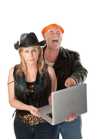Serious woman with loud mouth friend laughing at silly or offensive content photo