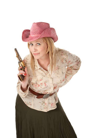 Woman with pink cowboy hat playing with a pistol Stock Photo - 7363429