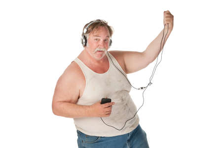 sweaty: Fat man with mp3 player dancing to music Stock Photo