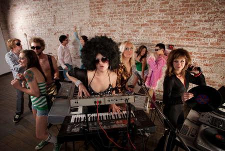 Pretty Female DJs Rocking a Disco Music Party photo